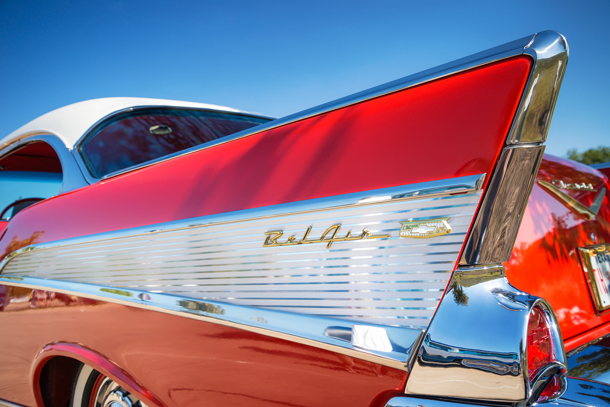 Westlake, Texas, USA - October 18, 2014: Tail fin and taillight details of a red 1957 Chevrolet Bel Air classic car.